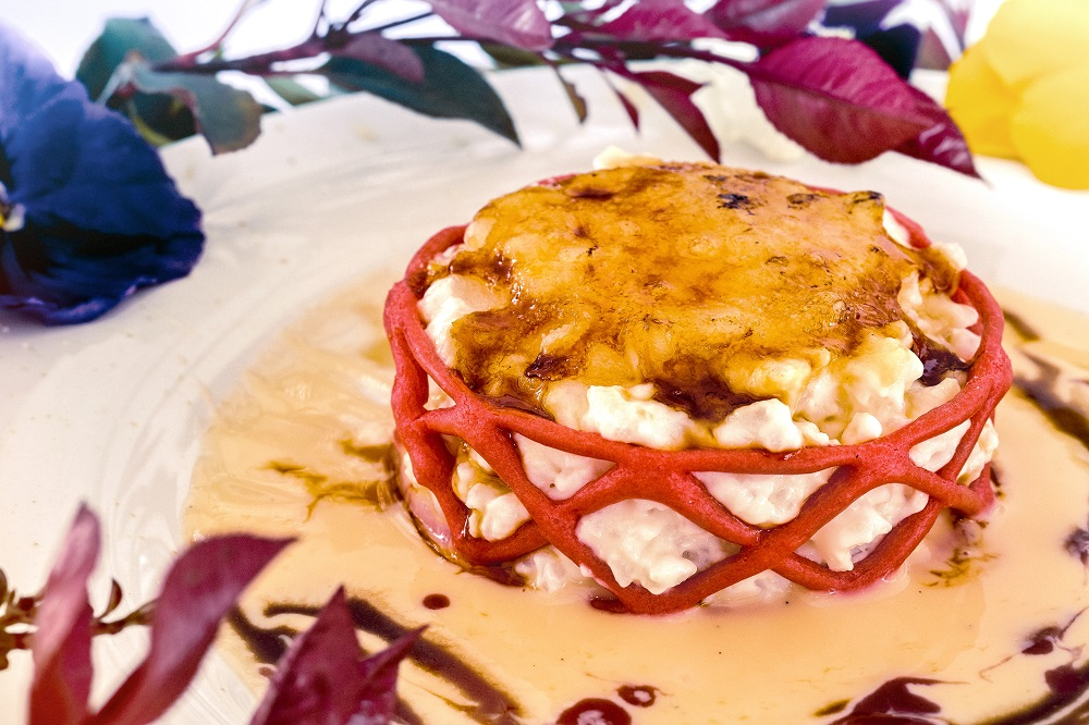 Arroz con leche quemado sobre crema inglesa del restaurante NIMÚ BISTRO